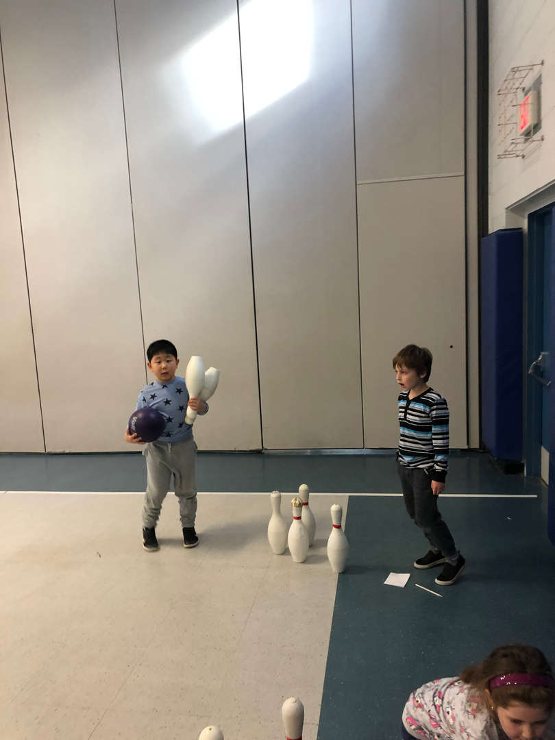 Student bowling during gym class