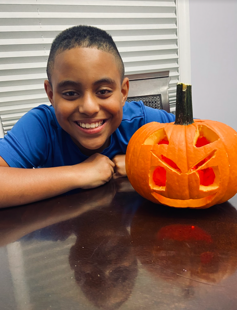 smiling with a pumpkin