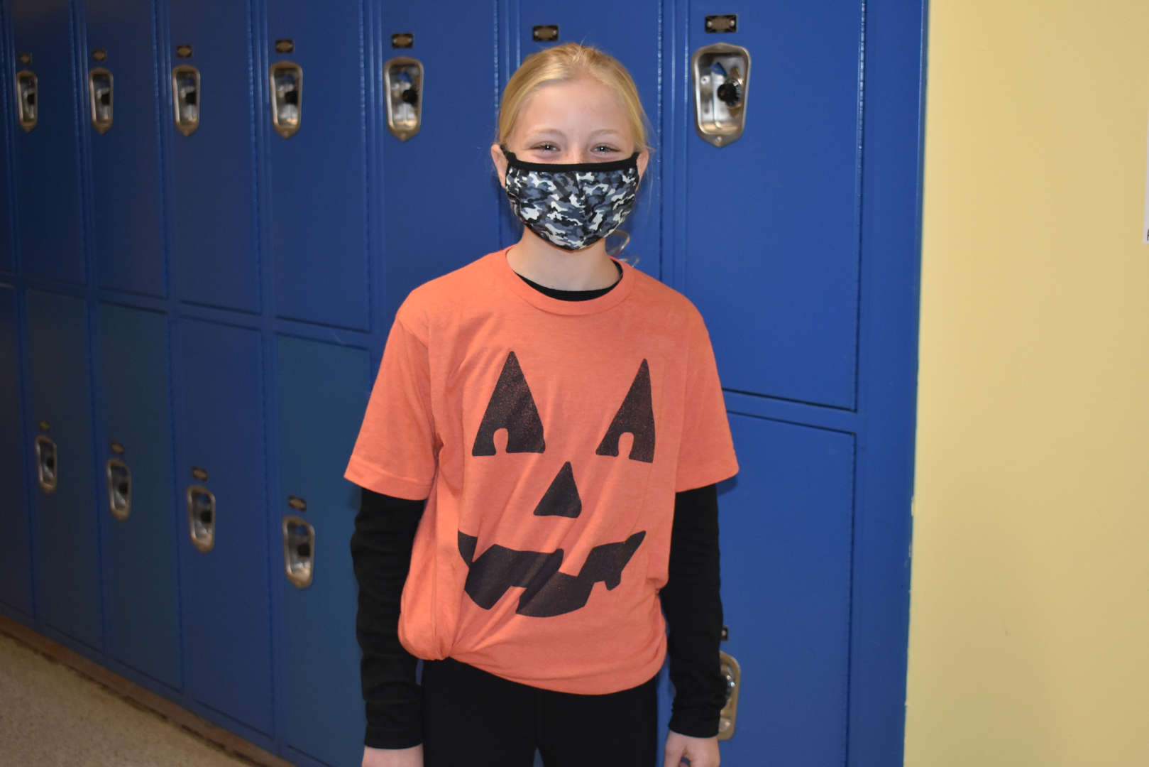 pumpkin shirt in the hallway