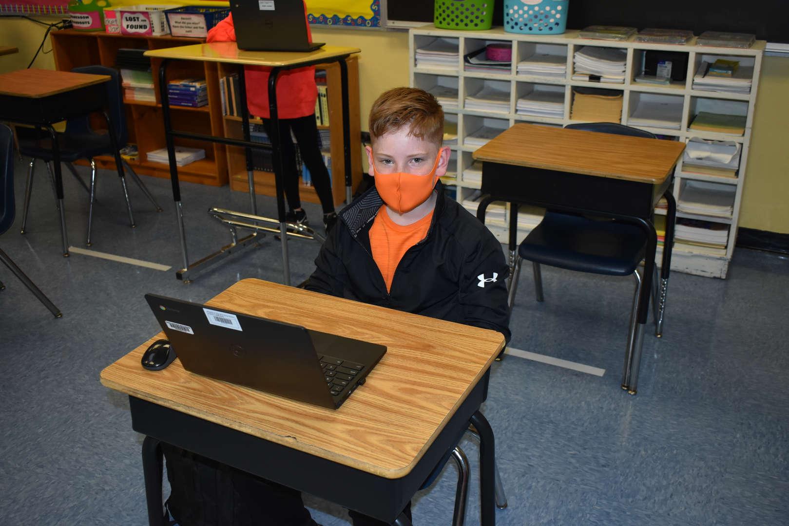 Orange mask at the desk