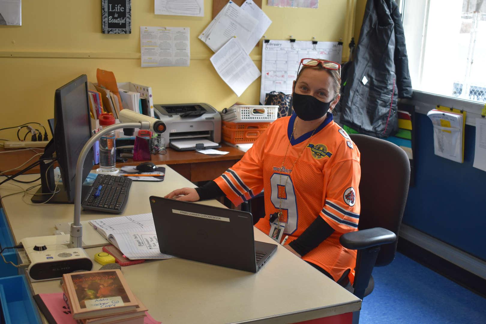 sports jersey at teacher desk