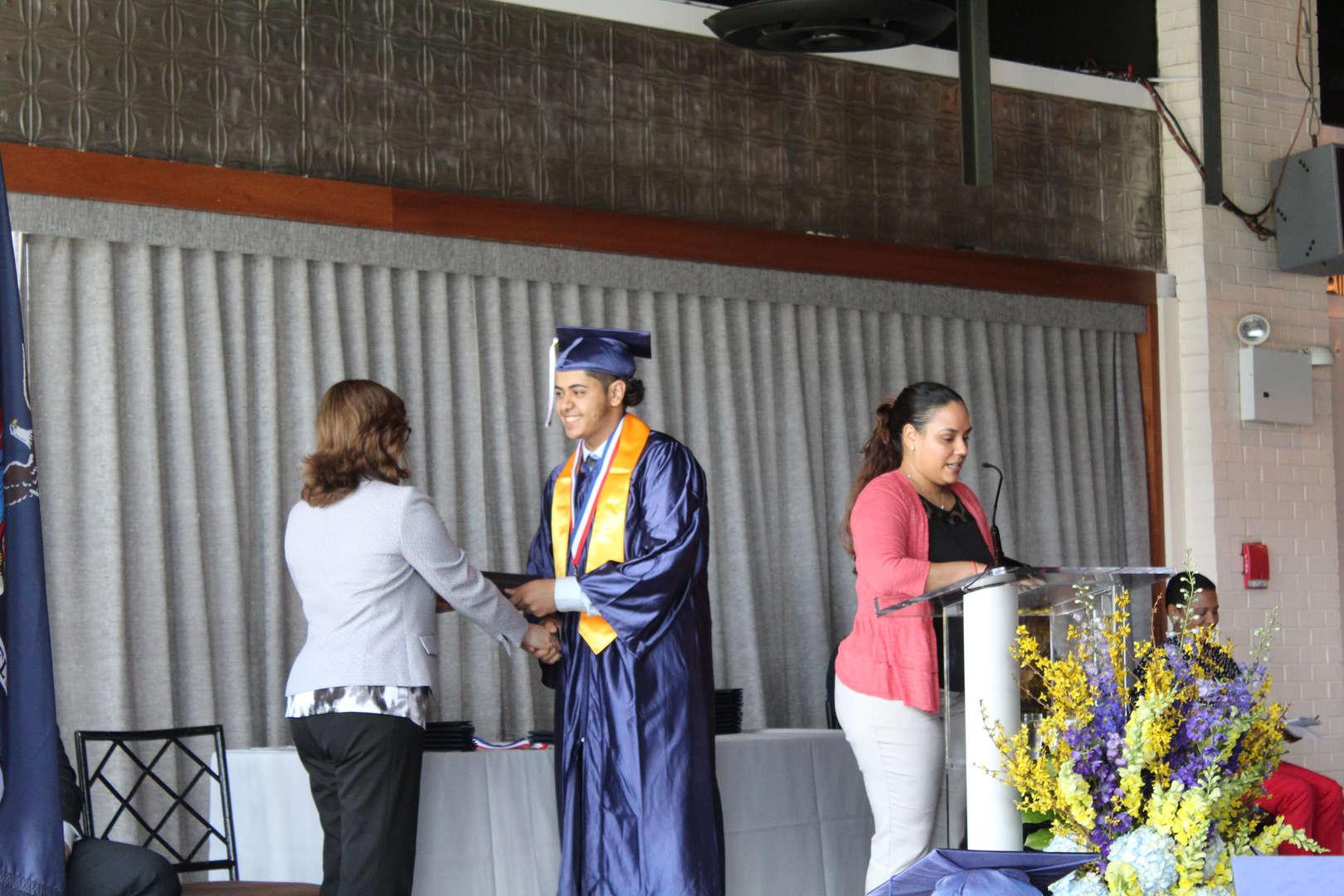 Principal giving diploma