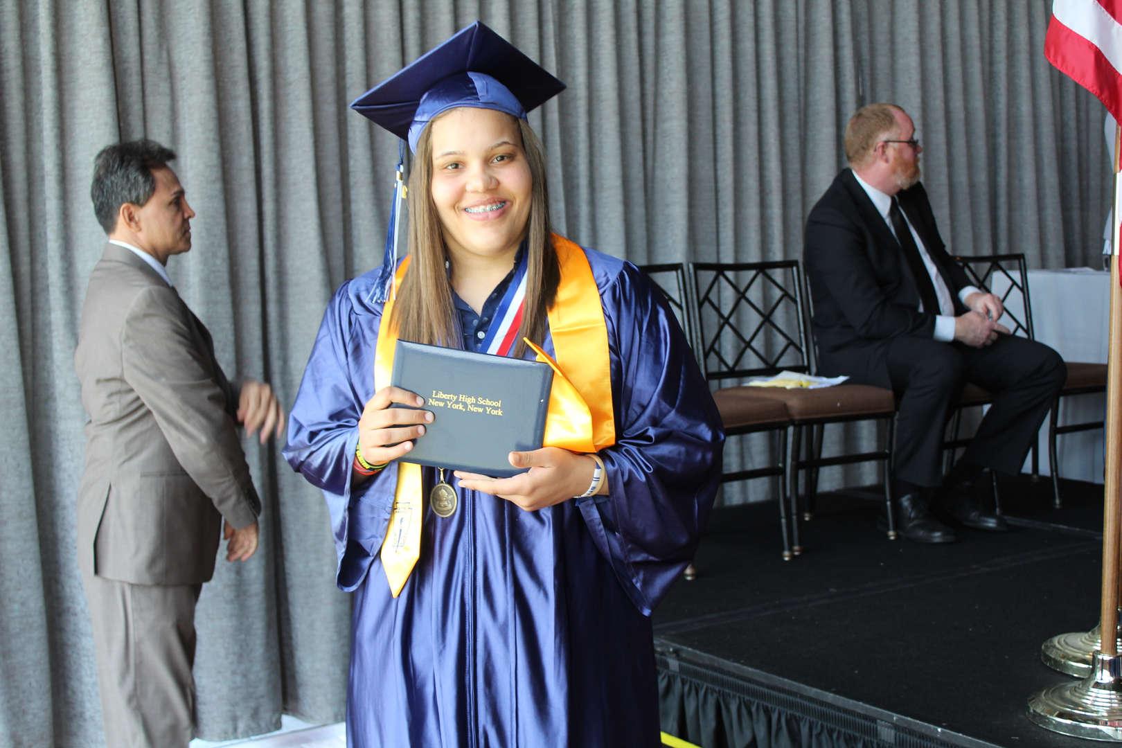 graduate showing diploma