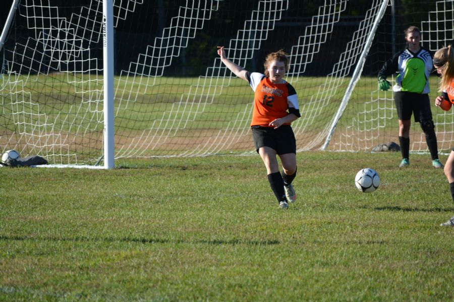 Picture of varsity girl student playing soccer