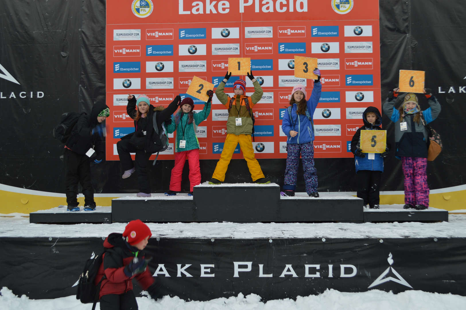 Elementary students standing on snowboarding podium