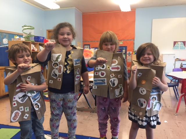 Pre-K students with alphabet vests