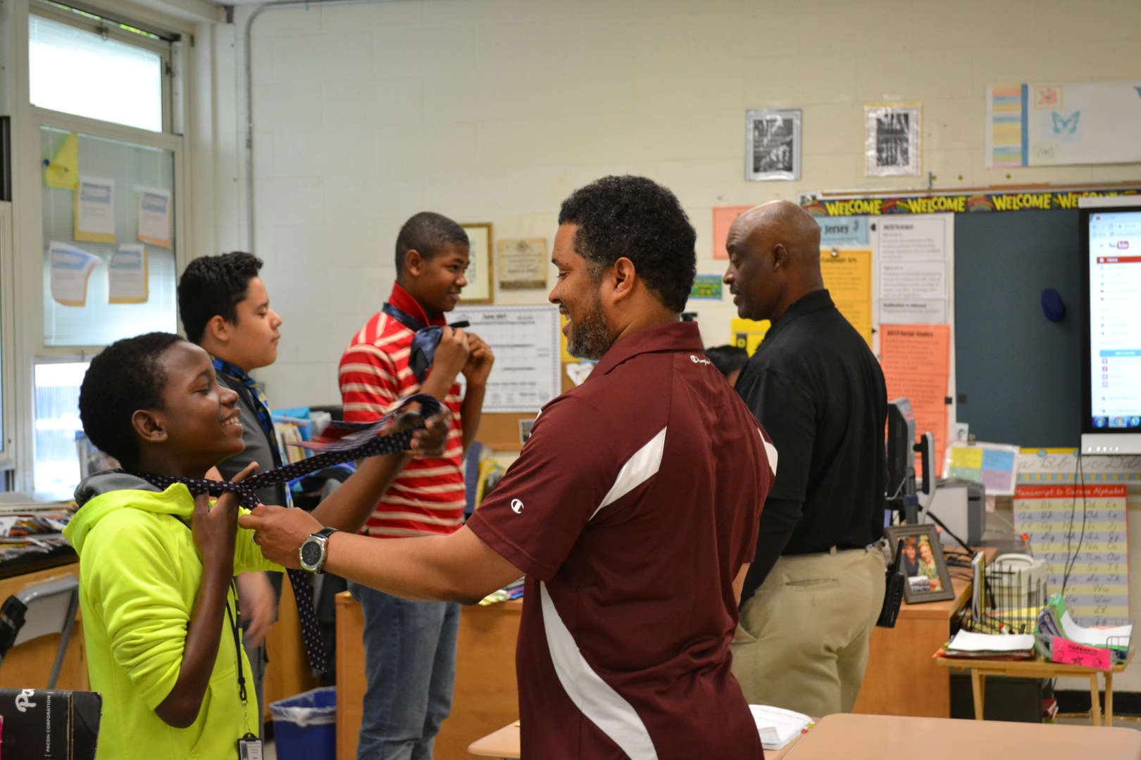 students learn how to tie a necktie
