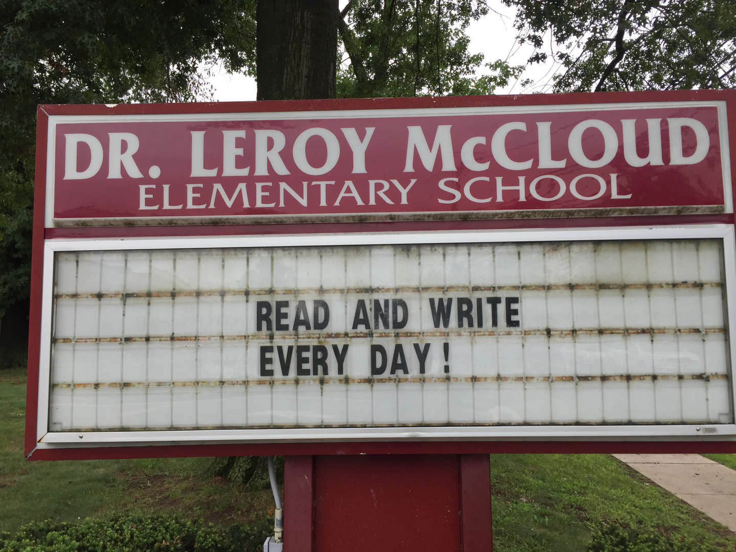 "Front sign ""read and write every day"""