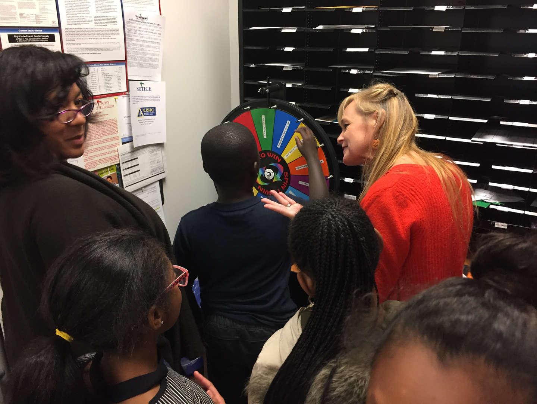 Teachers at the PBSIS prize wheel