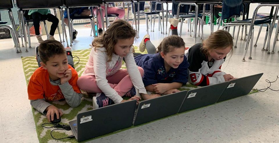 Bayville School third graders work together.