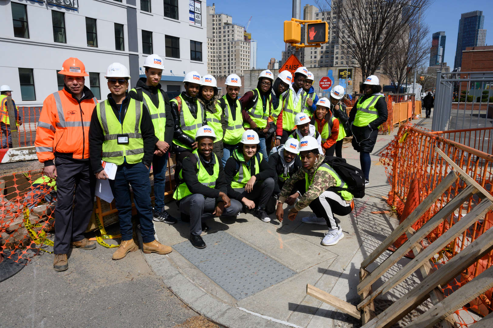 Students participating in a site visit with the Department of Buildings