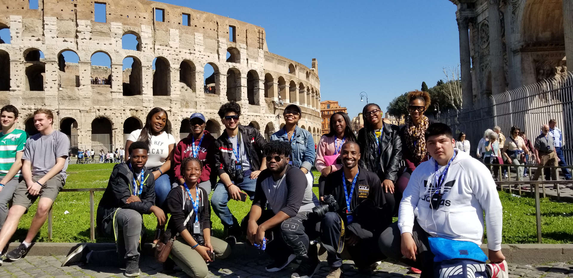 Participants posing in front of the Colosseum while on a trip to Rome