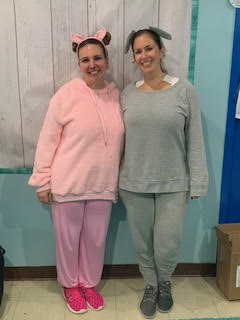 two teachers dressed up in their pajamas for pajama day.