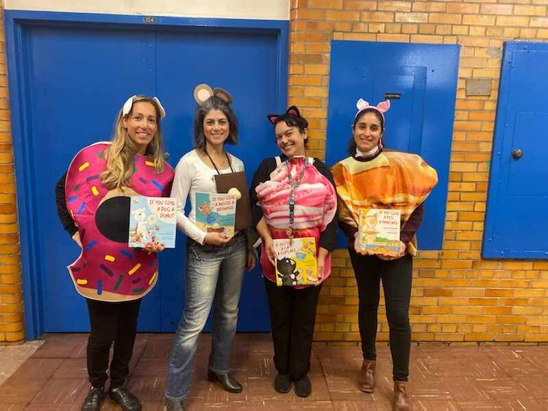 four teachers dressed up as donuts on character day.