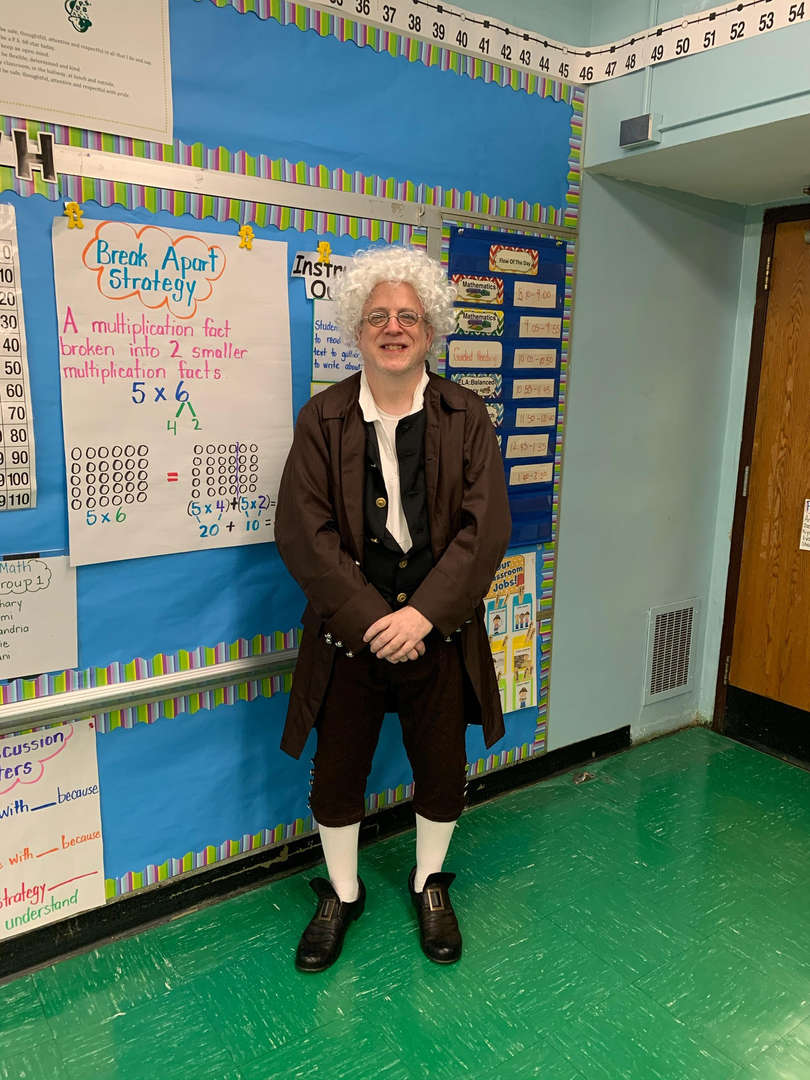 Social studies teacher dressed up for character day.