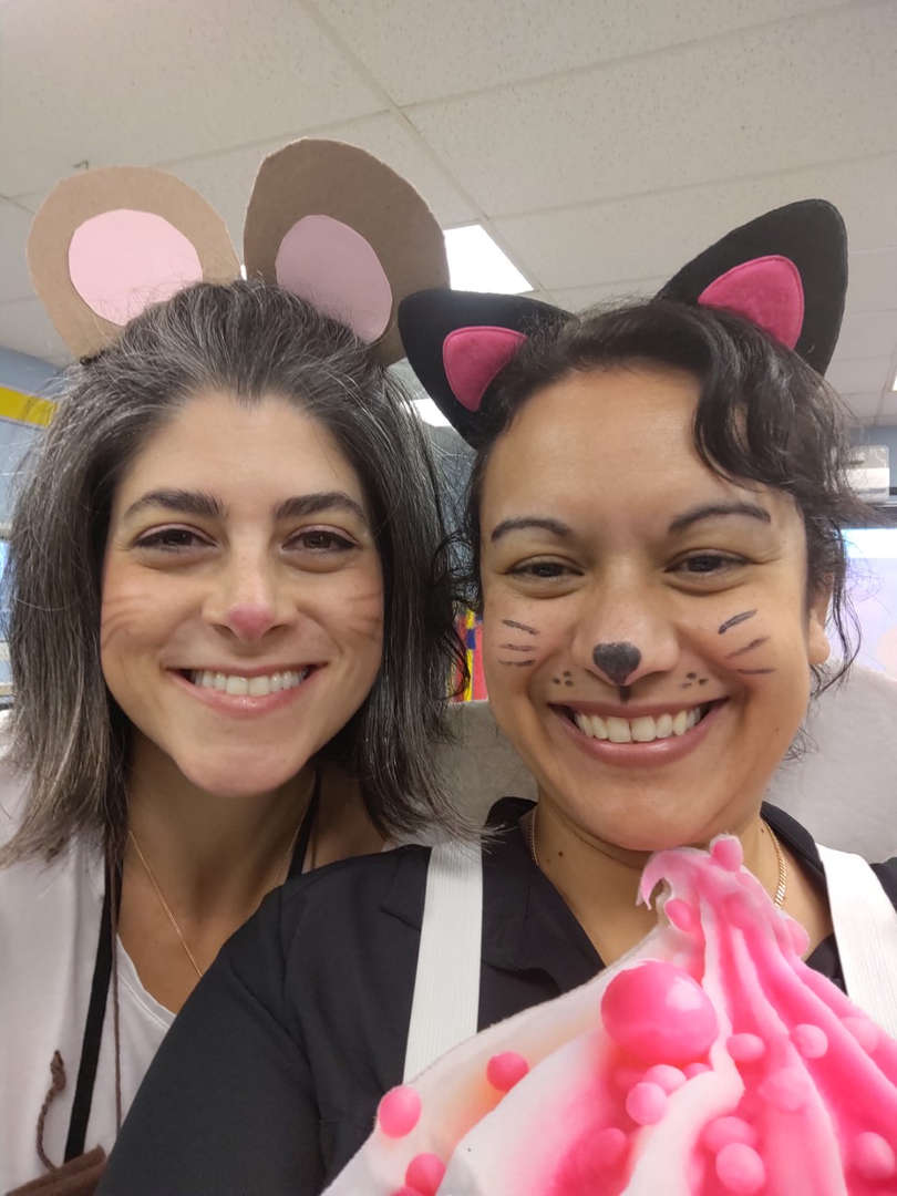 two teachers dressed up as a cat and a mouse for character day.