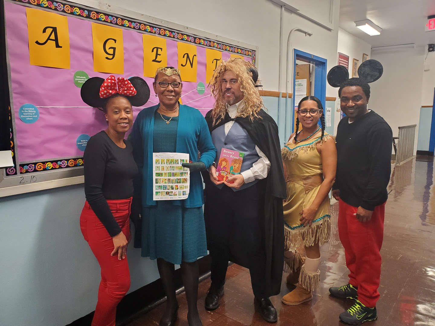 five teachers/administrators dressed up for character day.