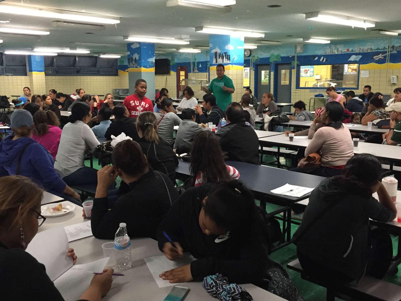 NSLA PTA Meeting, Parent Listening the Principal