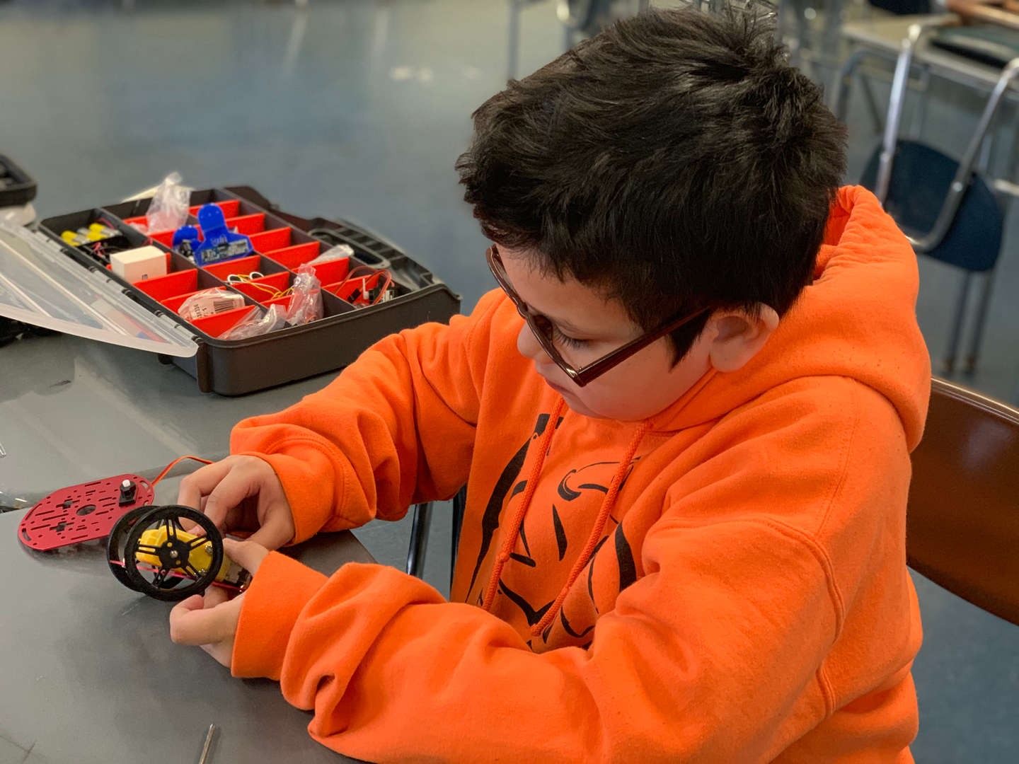 NSLA Robotics Club, Student working on the wheels of a robot