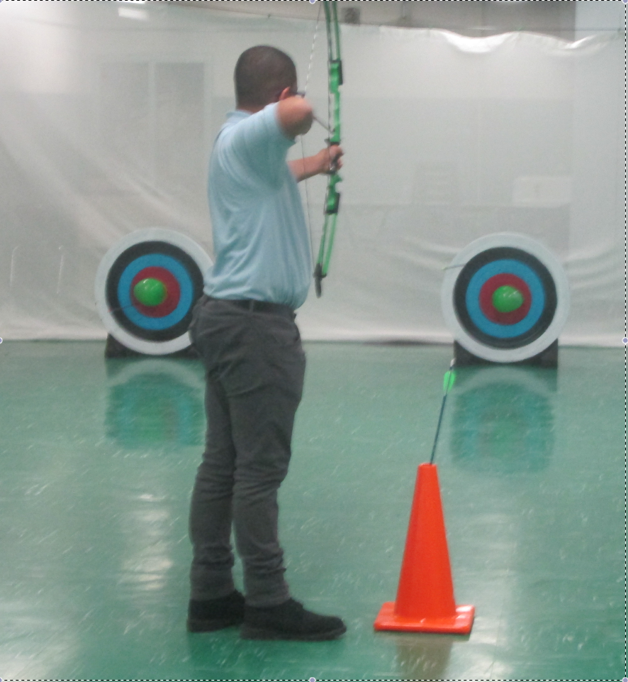 NSLA archery practice, student aiming at target