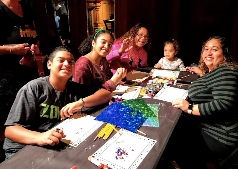 NSLA family smiling while making art at the Park Avenue Armory
