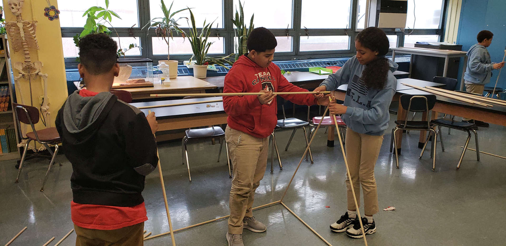 NSLA Students constructing a wooden structure