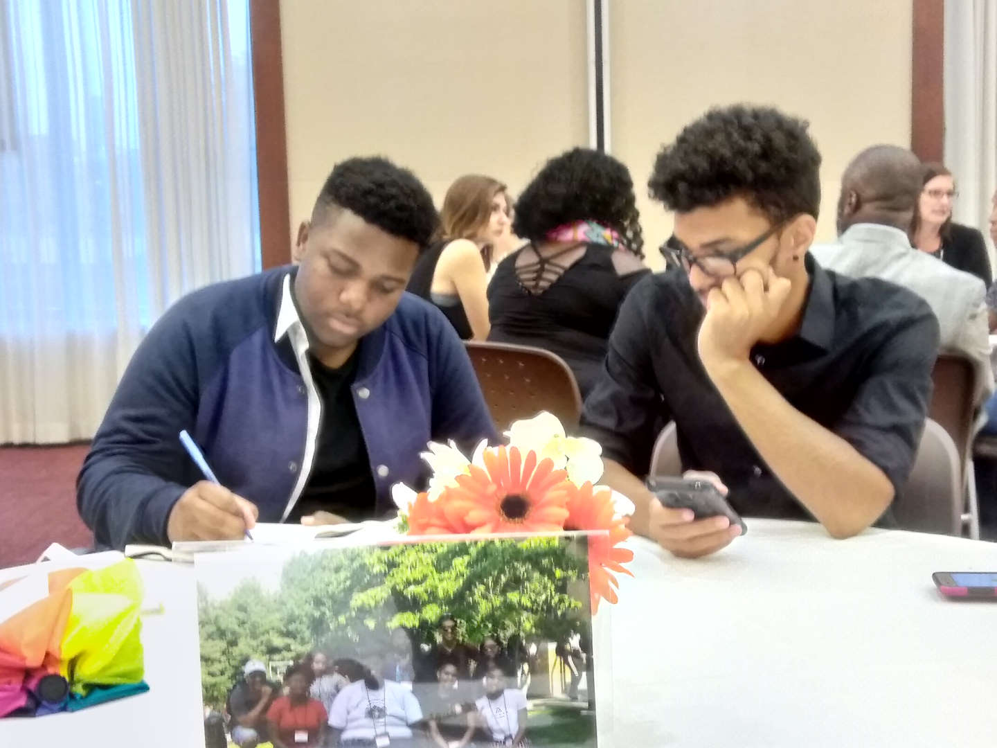students work at table Peer Forward Summer Training