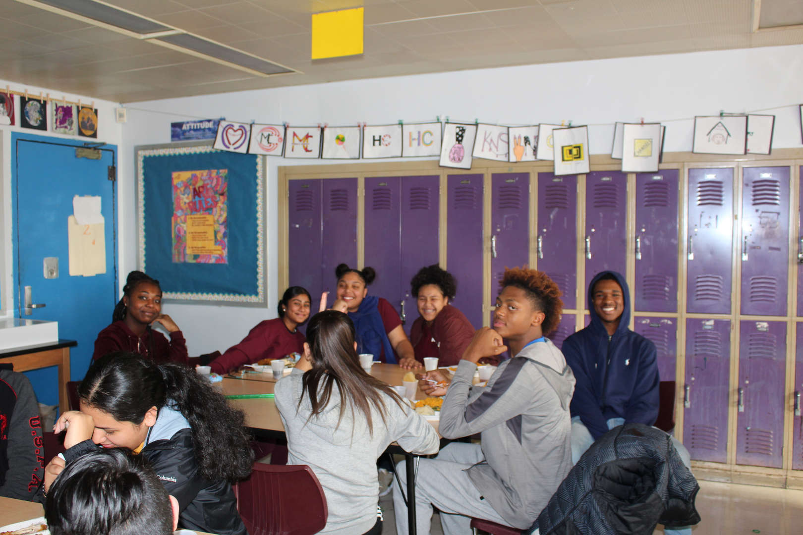students in room for holiday feast