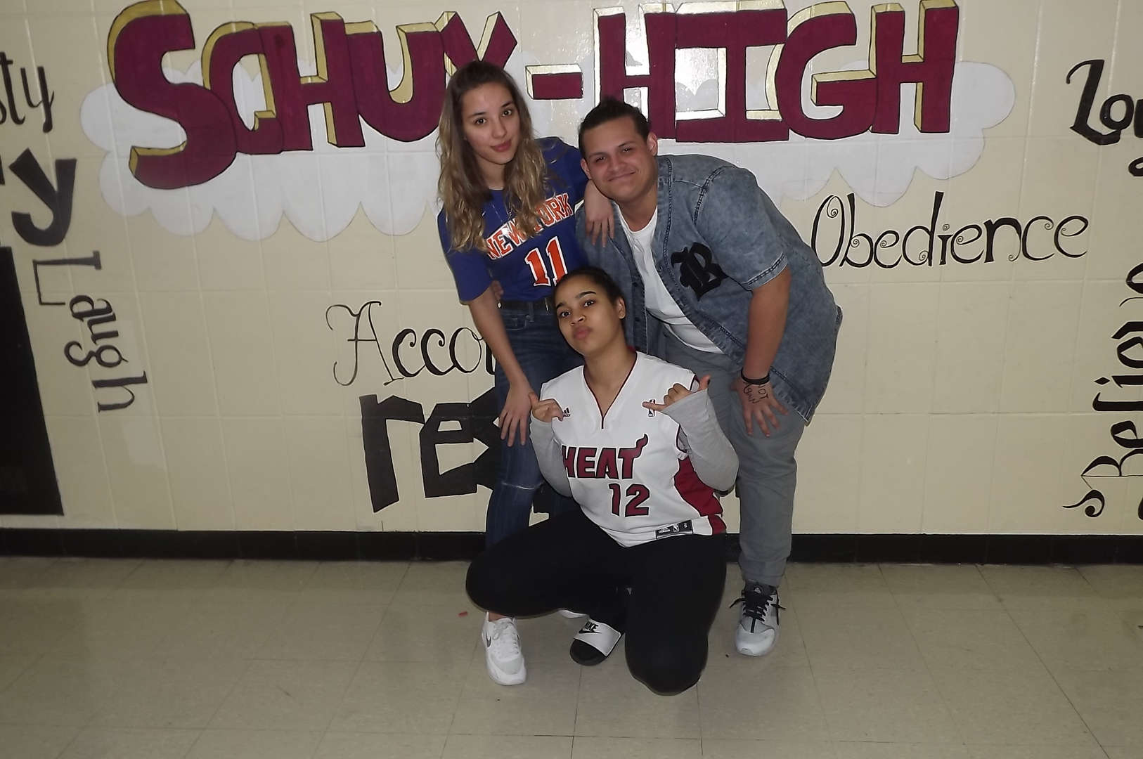 girls pose with jerseys