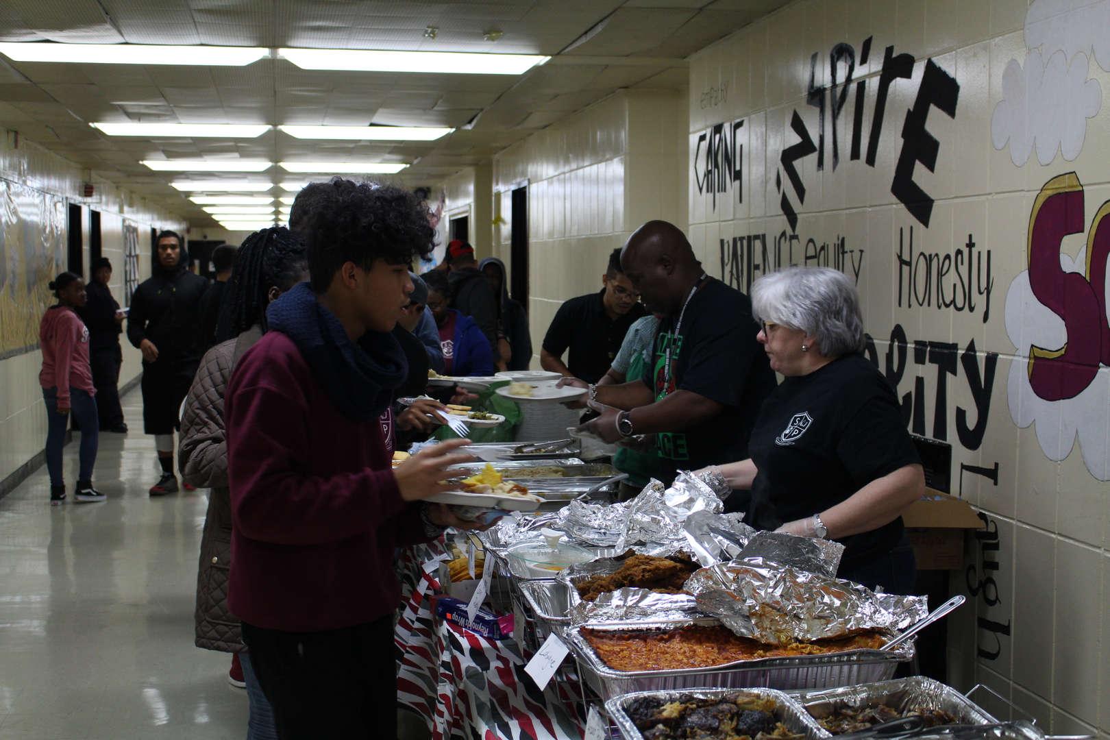 Teachers serving food Thanksgiving Feast 2017
