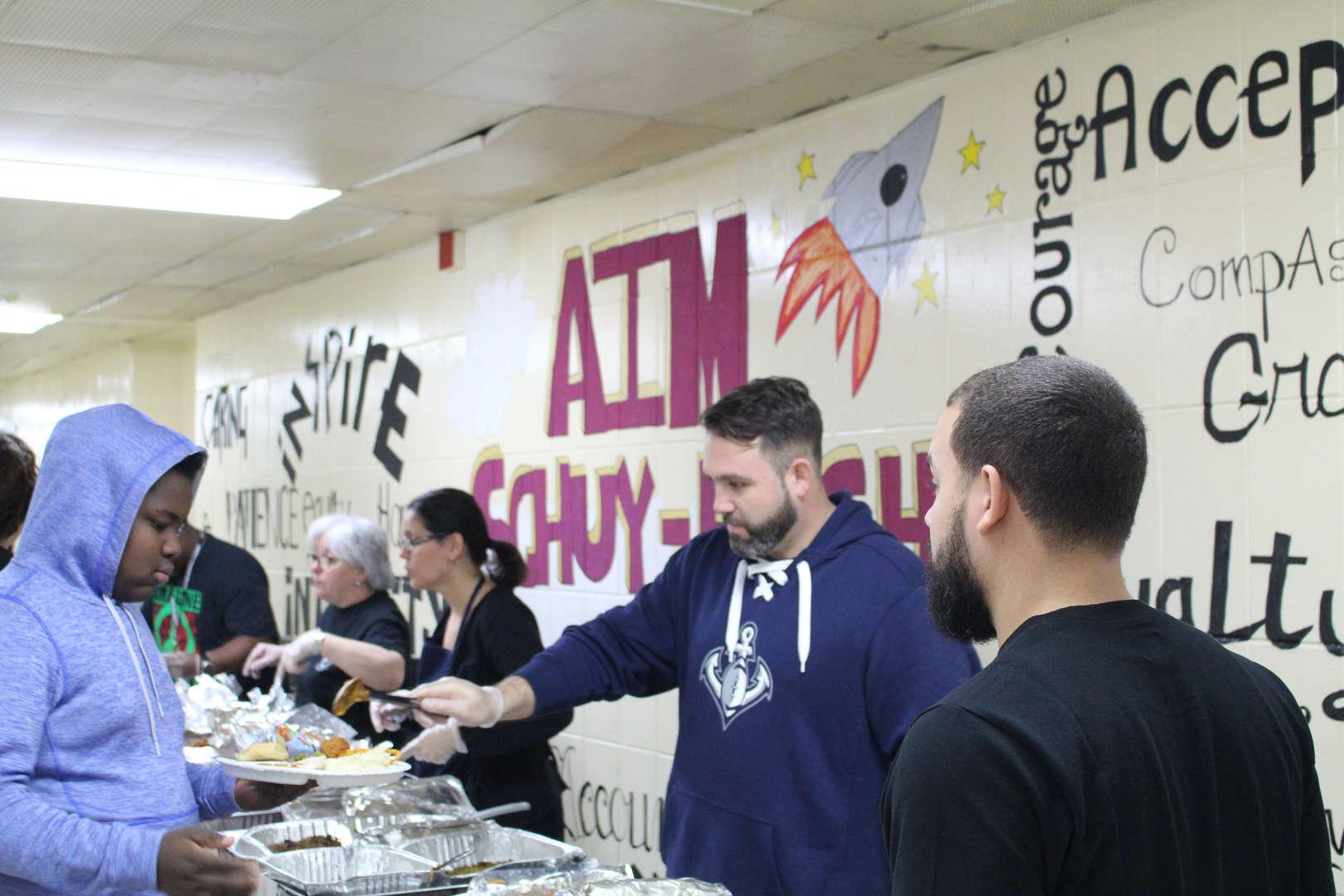 Tamburro serves food Thanksgiving Feast 2017