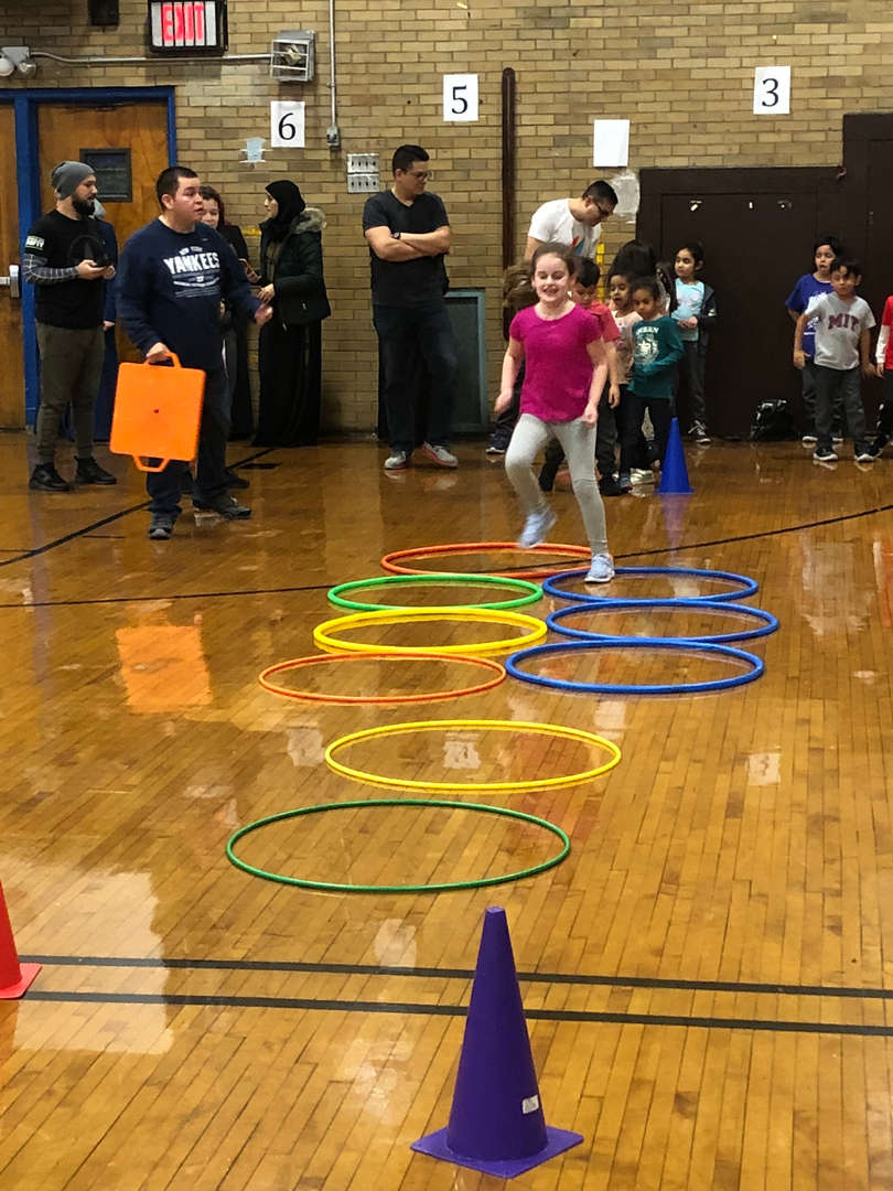 A student stepping in hoops.