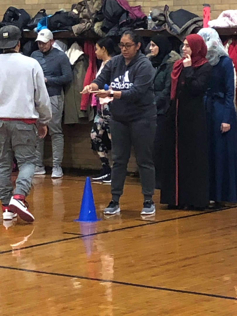 A student in an egg race that is about to begin.