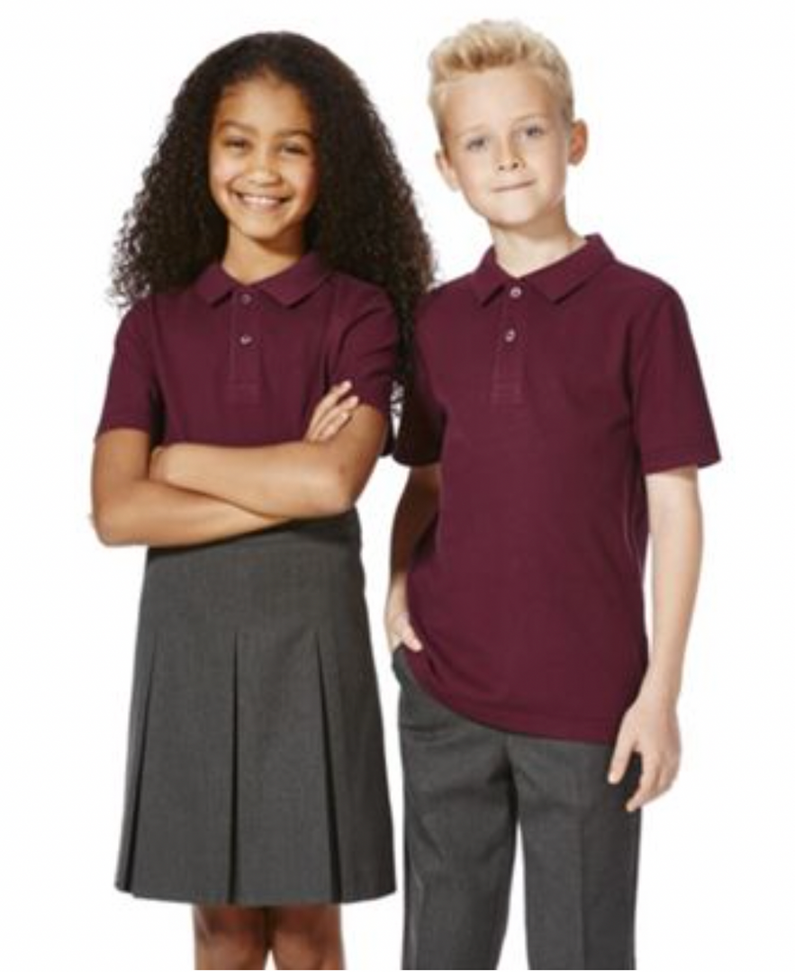 Two students wearing the school uniform of burgundy polo shirts and dark gray bottoms.