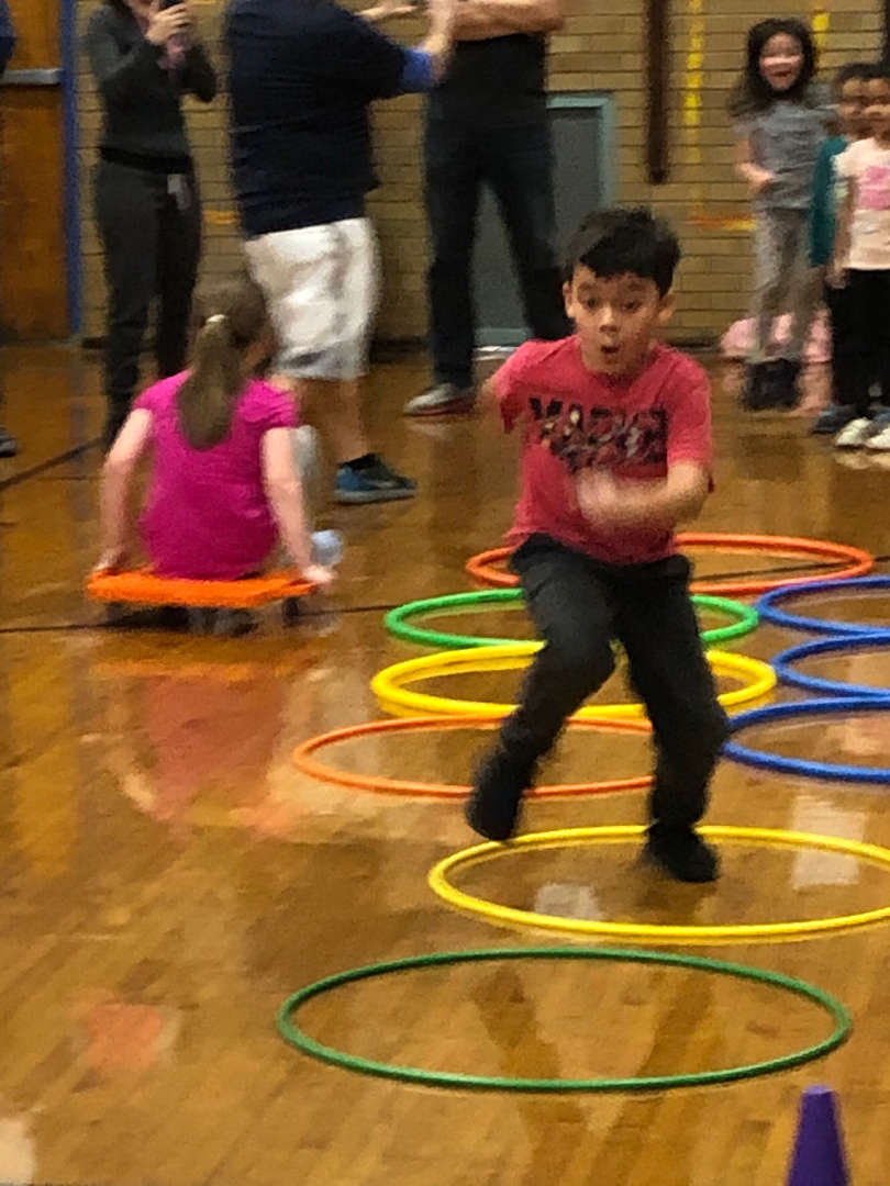 Another student racing through various hoops and reaching the end.