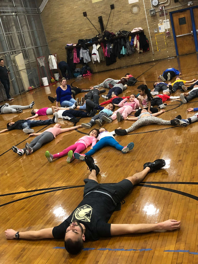 A group of students stretching.