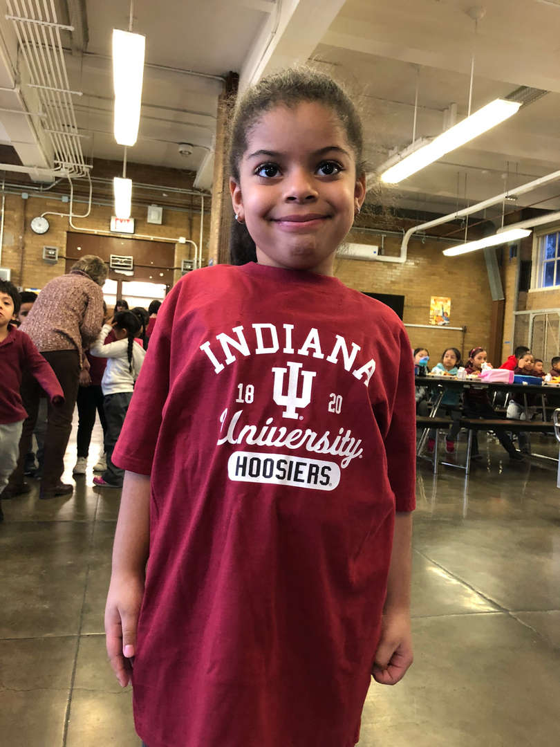 A student shows off her Indiana University t-shirt.