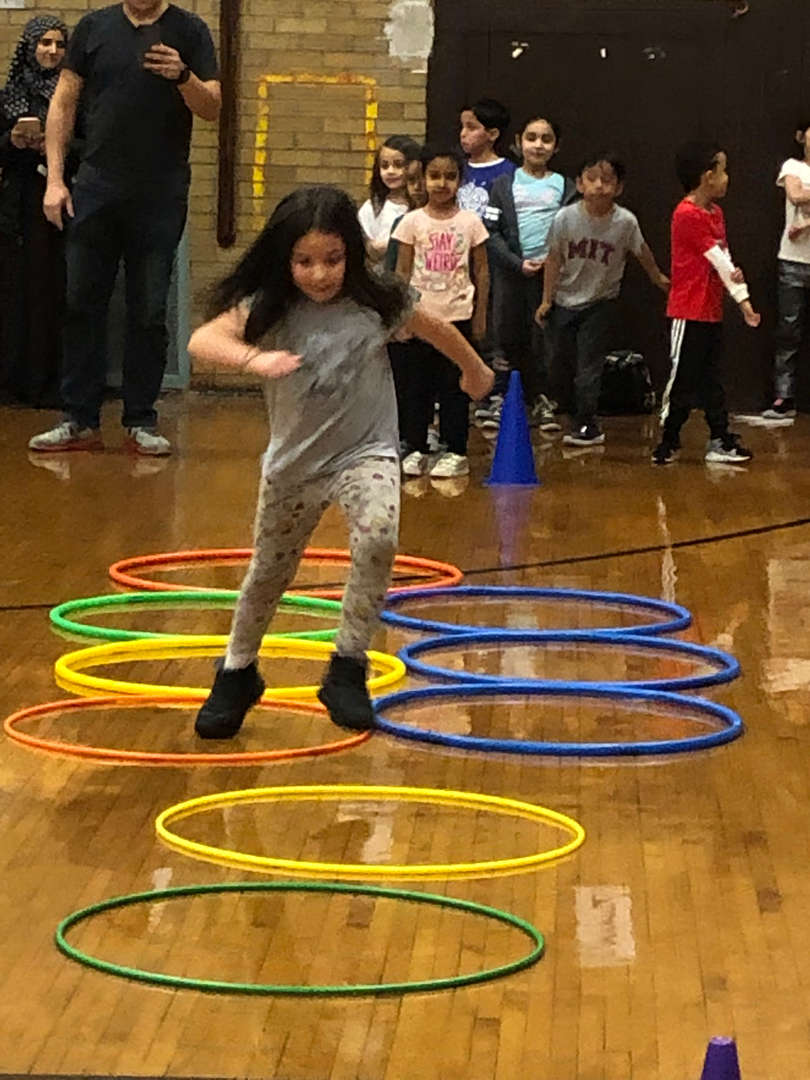 Another student racing through various hoops.
