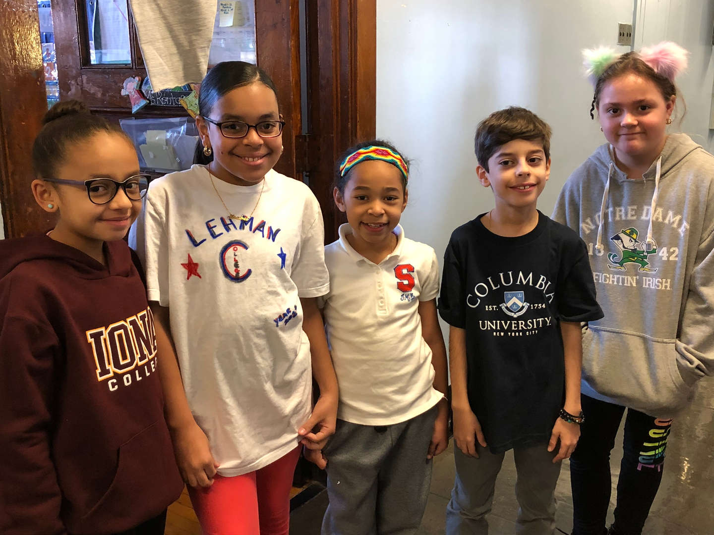 5th graders showing their college gear.