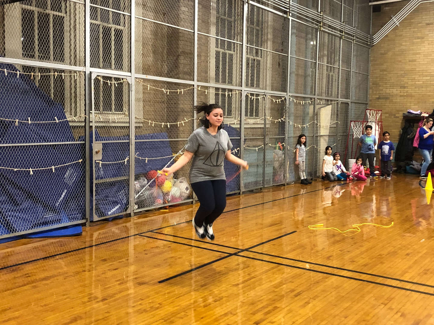 A person jumping rope in the school's gym.