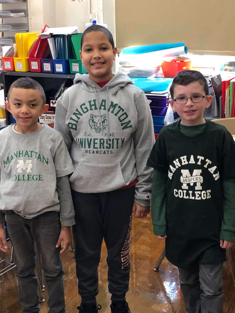Three students wearing college gear.