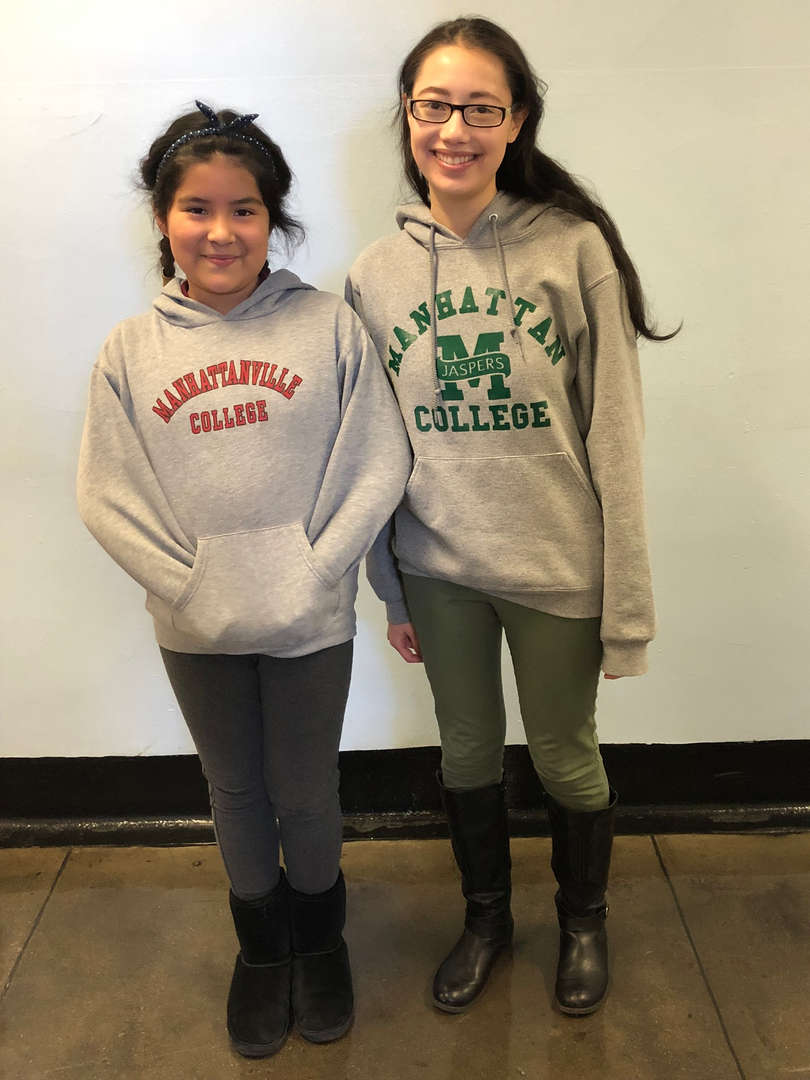 Two students wearing college sweatshirts.
