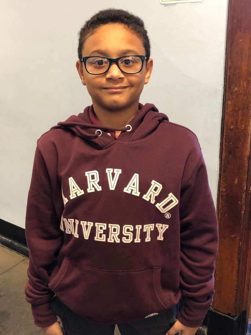 Student wearing his Harvard University sweatshirt.