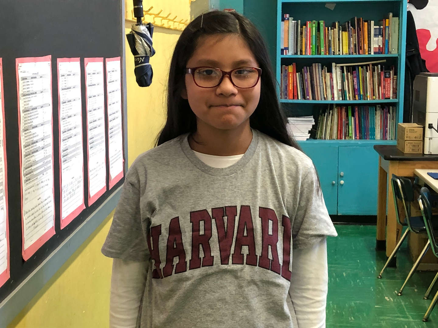 Student showing off her Harvard University t-shirt.
