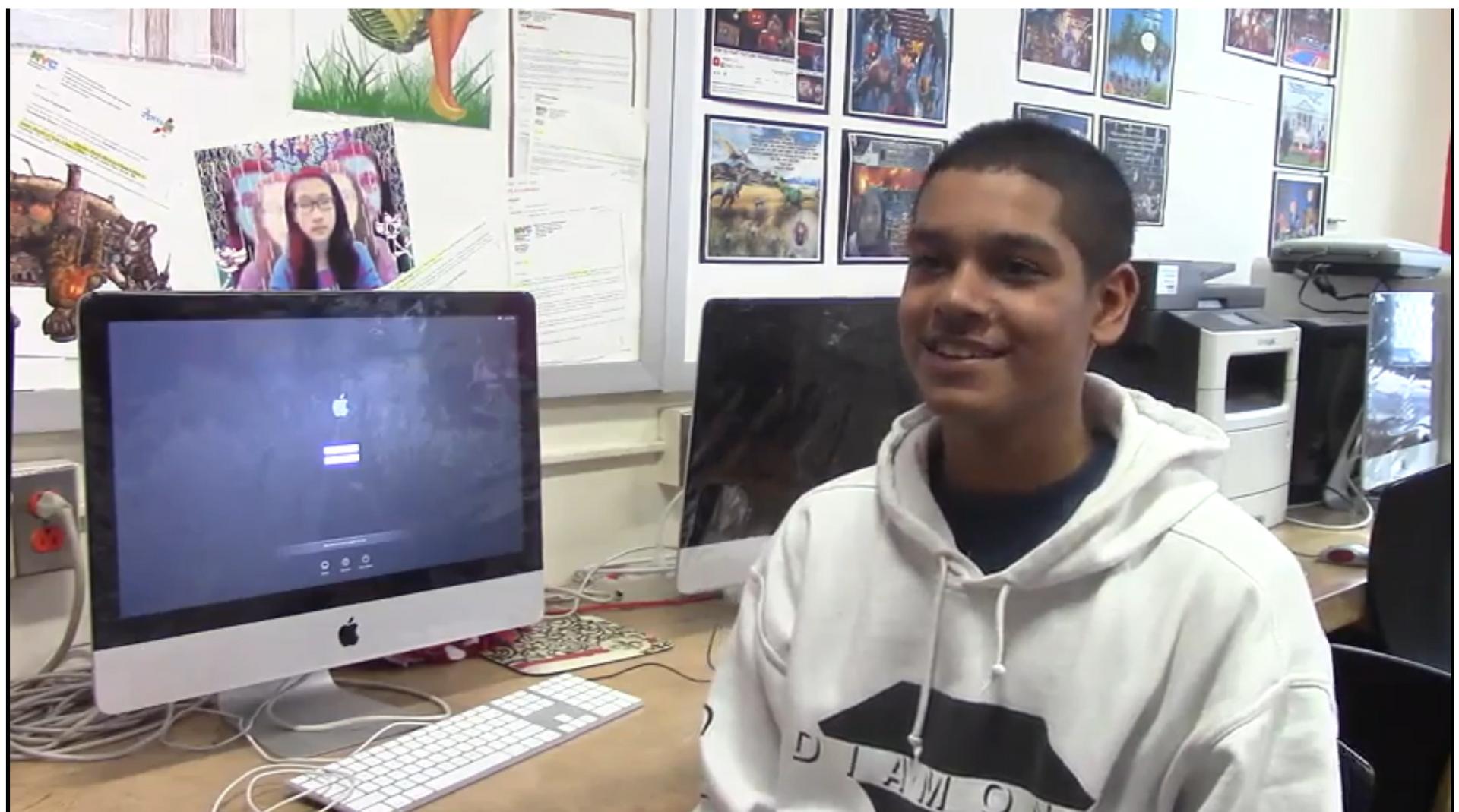 student sitting at laptop