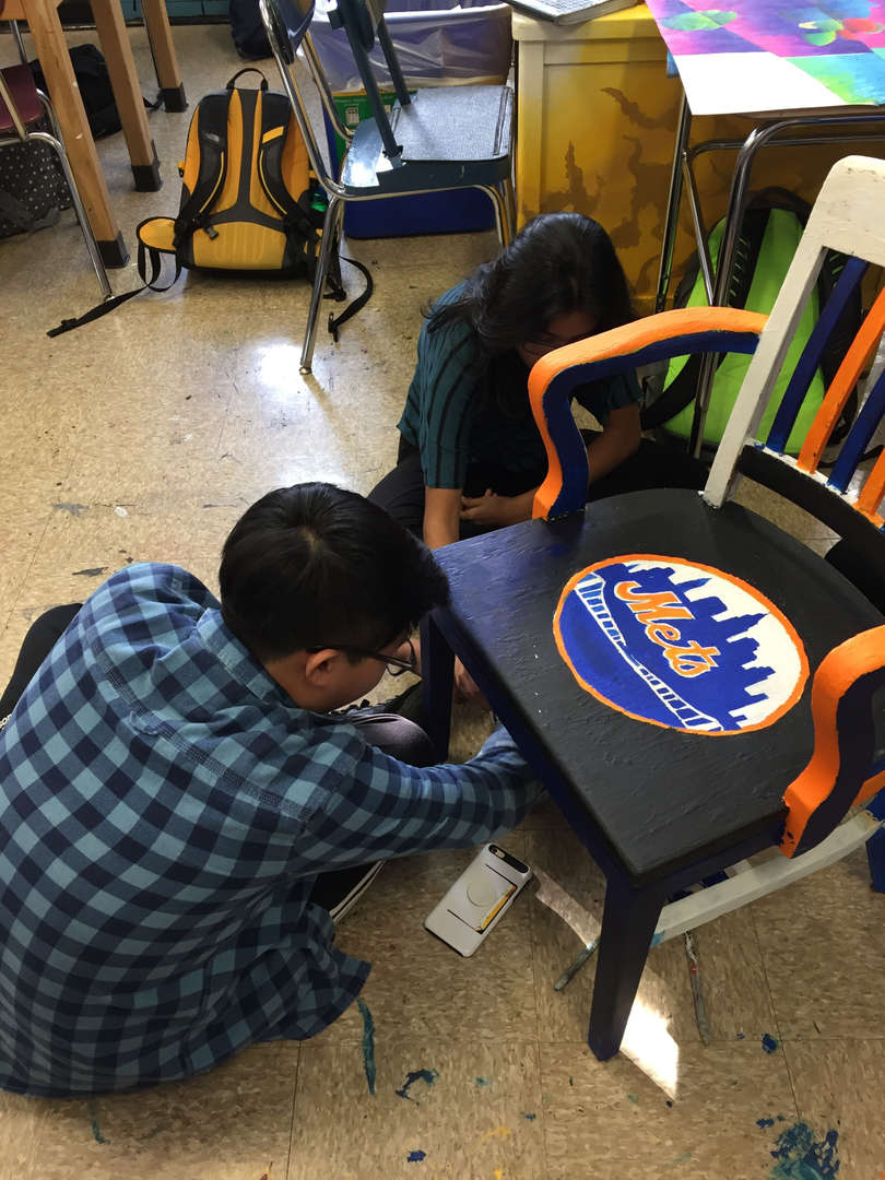 Student painting chair