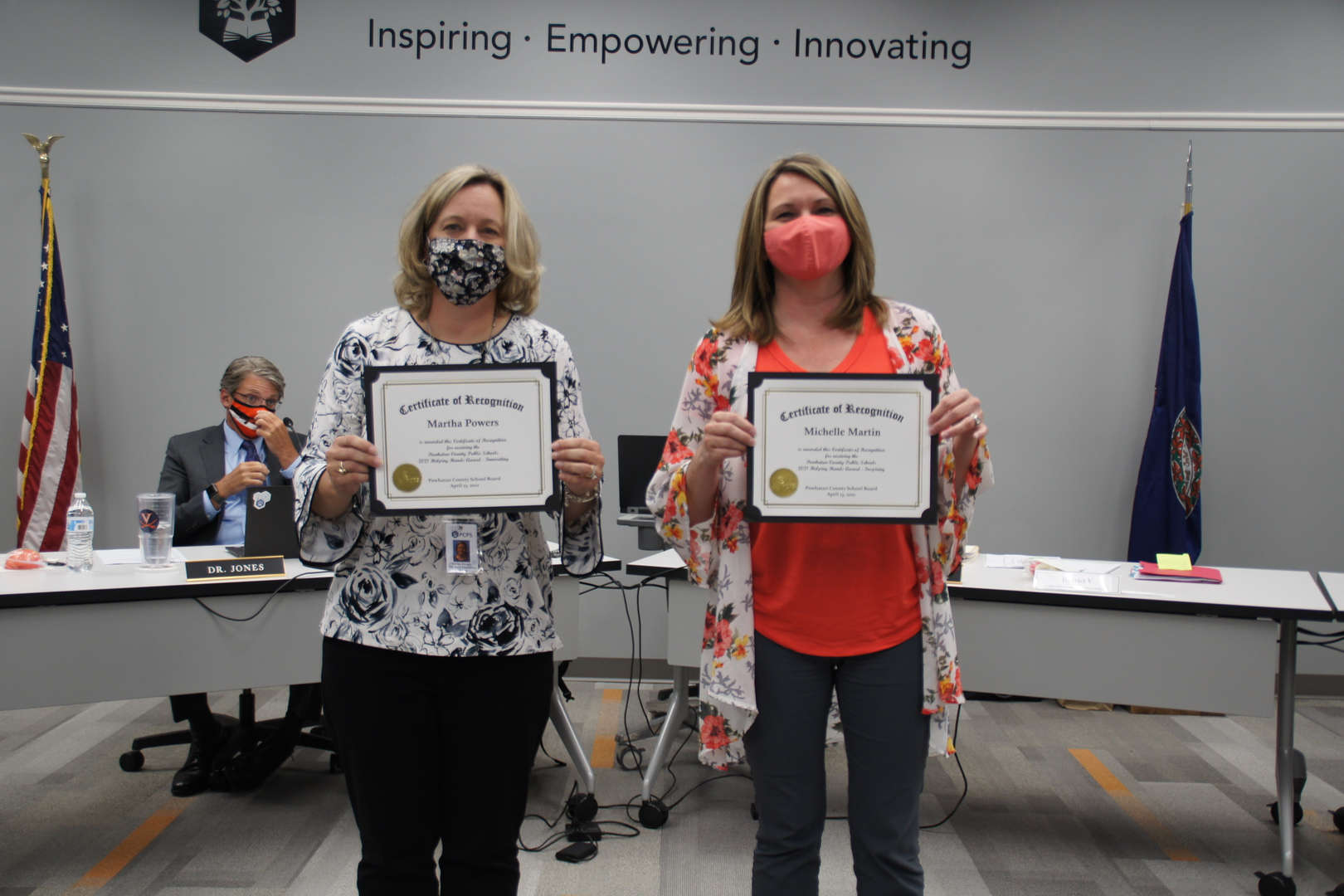 Dr. Martha Powers & Mrs. Michelle Martin receive helping hands awards