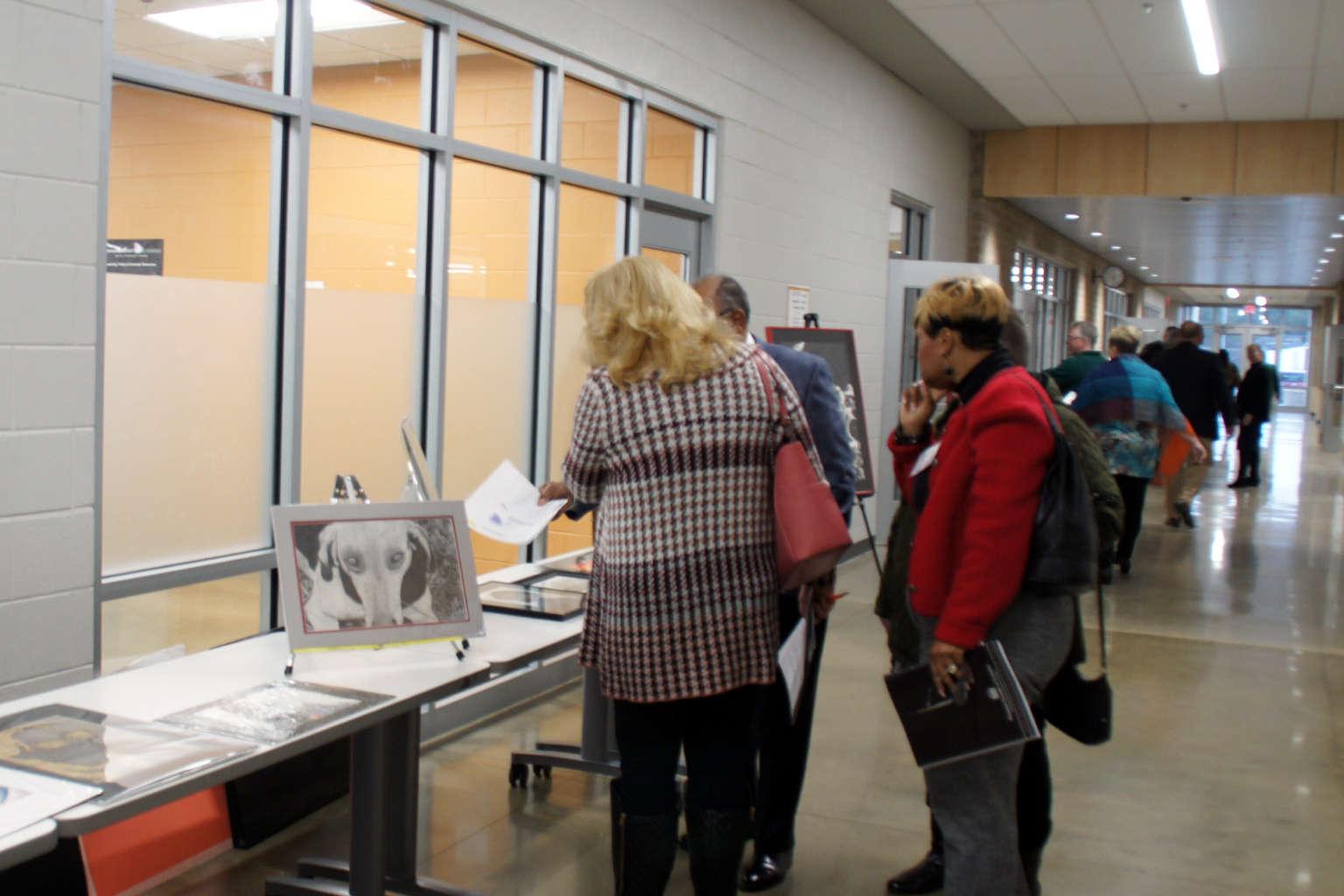 Art Judges viewing artwork at the Southside Regional Forum