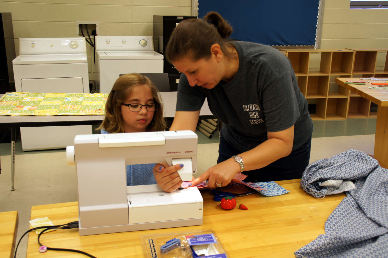 Instructor and student sewing at the Quilting Summer Camp