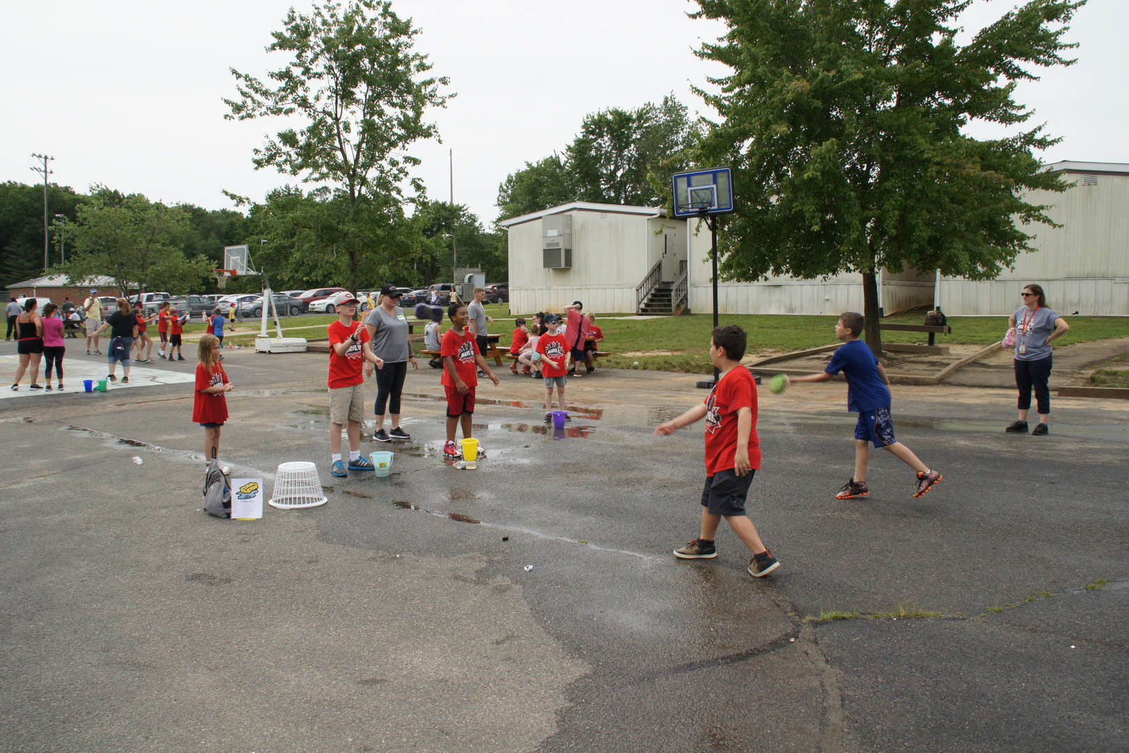 Pocahontas Elementary School Field Day - Students playing wet sponge game